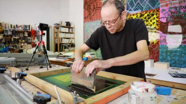 Portrait of the artist Jean-Pierre Sergent silkscreening his Shakti-Yoni: Ecstatic Cosmic Dances Series #54